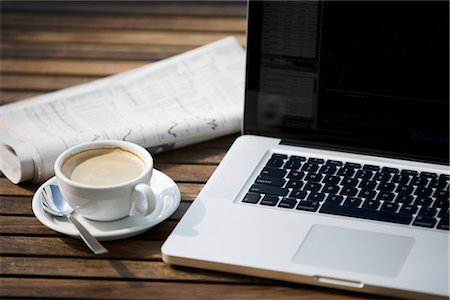 Laptop Computer, Newspaper and a Cup of Coffee Stock Photo - Rights-Managed, Code: 700-03014799