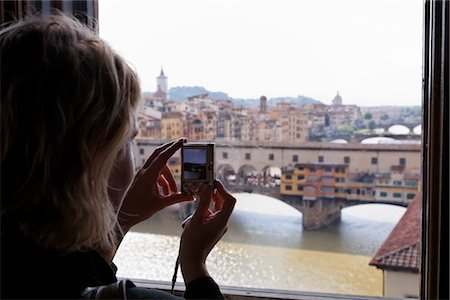 Woman Taking Pictures of Ponte Vecchio, Florence, Tuscany, Italy Stock Photo - Rights-Managed, Code: 700-03015134