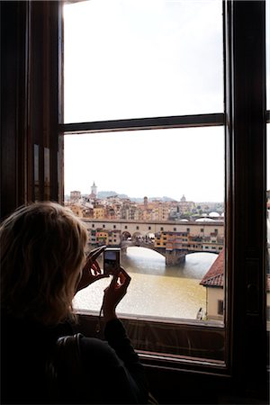 Woman Taking Pictures of Ponte Vecchio, Florence, Tuscany, Italy Stock Photo - Rights-Managed, Code: 700-03015135