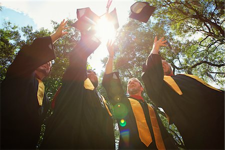Graduate Throwing Mortarboards in the Air Stock Photo - Rights-Managed, Code: 700-03017534