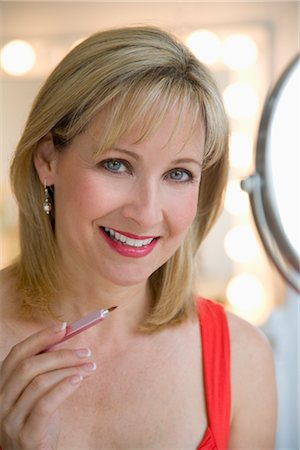 Woman Applying Make-up Stock Photo - Rights-Managed, Code: 700-03017728