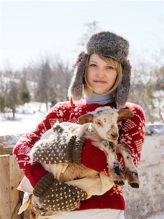 farmhand (female) - Woman Holding Newborn Lamb Stock Photo - Rights-Managed, Code: 700-03017743