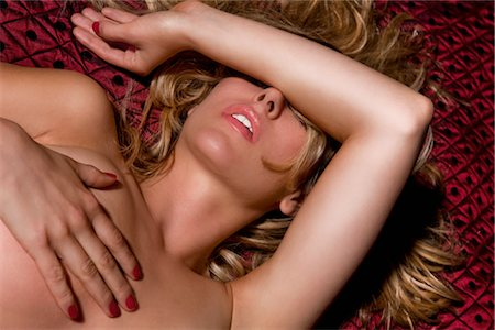 female nude breast sexy - Nude Woman on Bed Stock Photo - Rights-Managed, Code: 700-03054115