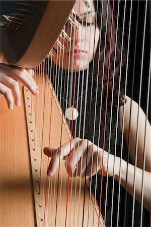 Woman Playing the Harp Stock Photo - Rights-Managed, Code: 700-03059198