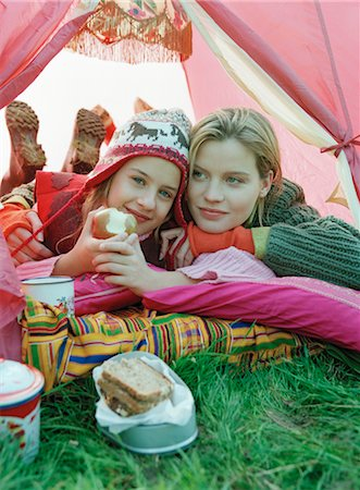 Mother and Daughter Cuddling inside Tent Stock Photo - Rights-Managed, Code: 700-03067836