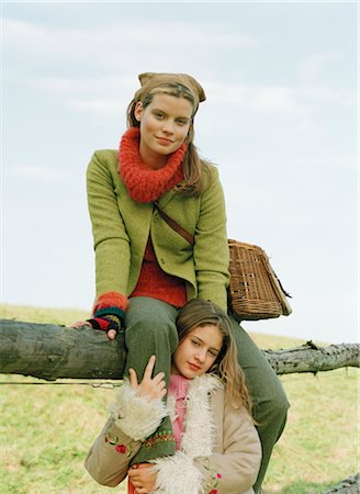 Mother and Daughter by Fence Stock Photo - Rights-Managed, Code: 700-03067837