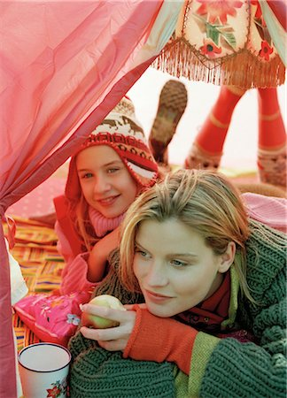 Mother and Daughter Cuddling in Tent Stock Photo - Rights-Managed, Code: 700-03067831