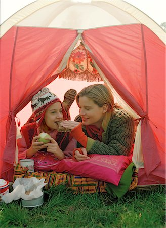Mother and Daughter Eating inside Tent Stock Photo - Rights-Managed, Code: 700-03067832