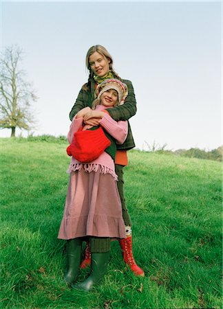 Portrait of Mother and Daughter Standing in Field Stock Photo - Rights-Managed, Code: 700-03067833