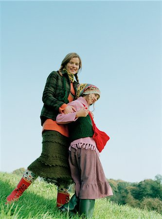 Mother and Daughter Standing in Field Stock Photo - Rights-Managed, Code: 700-03067844