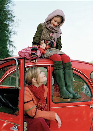 Mother and Daughter Sitting in Parked Car Stock Photo - Rights-Managed, Code: 700-03067840