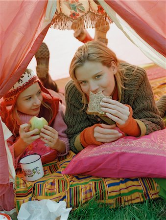 Mother and Daughter Cuddling inside Tent Stock Photo - Rights-Managed, Code: 700-03067841