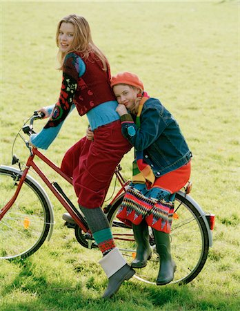 Mother and Daughter Riding Bike Together Stock Photo - Rights-Managed, Code: 700-03067842