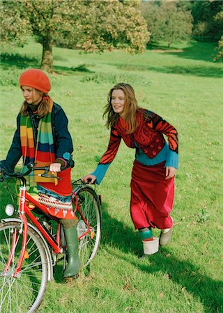 Mother pushing Daughter on Bicycle Stock Photo - Rights-Managed, Code: 700-03067843