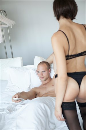 Man in Bed Ignoring Woman in Lingerie Stock Photo - Rights-Managed, Code: 700-03075528