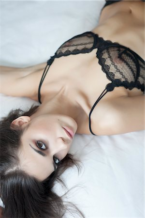 Portrait of Woman in Lingerie Lying in Bed Stock Photo - Rights-Managed, Code: 700-03075531