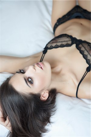 Portrait of Woman in Lingerie Lying in Bed Stock Photo - Rights-Managed, Code: 700-03075532