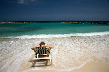 Man on Beach, Avila Beach, Curacao, Netherlands Antilles Stock Photo - Rights-Managed, Code: 700-03075817