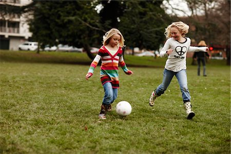 family shoes - Girls Playing Soccer Stock Photo - Rights-Managed, Code: 700-03075876