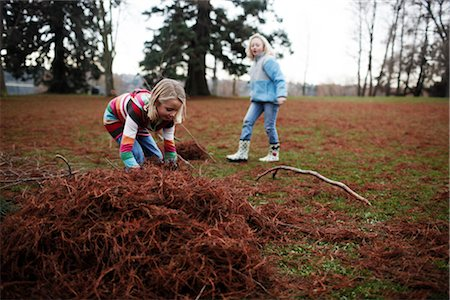 pile leaves playing - Girls Playing Outdoors Stock Photo - Rights-Managed, Code: 700-03075882