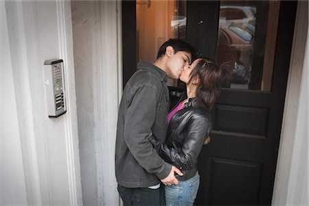 Young Couple Kissing in Doorway Stock Photo - Rights-Managed, Code: 700-03152526