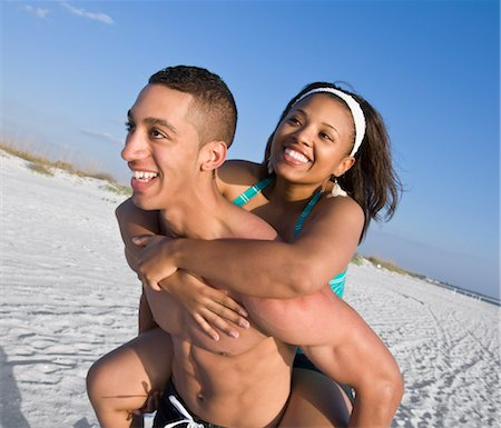 Man Giving Woman Piggyback Ride at Beach Stock Photo - Rights-Managed, Code: 700-03152591
