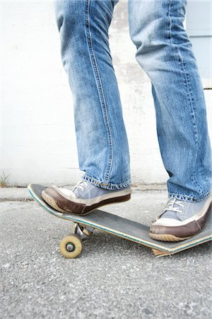 Teenager Standing on Broken Skateboard Stock Photo - Rights-Managed, Code: 700-03178528