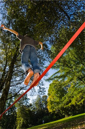 Boy Slacklining Stock Photo - Rights-Managed, Code: 700-03179169