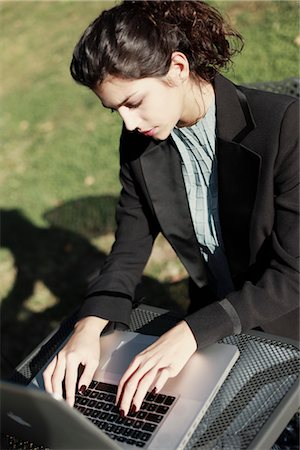 school work - Woman Using Laptop Stock Photo - Rights-Managed, Code: 700-03229317
