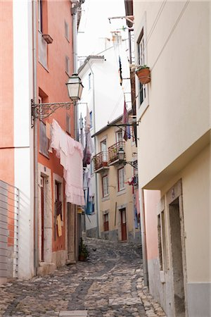 Laundry Hanging in Alley, Lisbon, Portugal Stock Photo - Rights-Managed, Code: 700-03230219