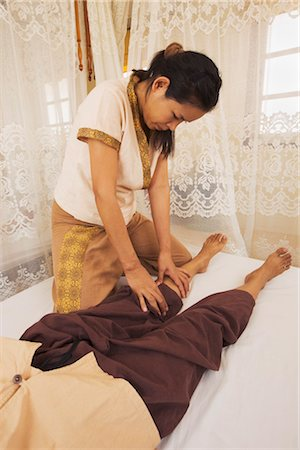 southeast asian ethnicity - Woman performing Thai Massage, Bangkok, Thailand Stock Photo - Rights-Managed, Code: 700-03230400