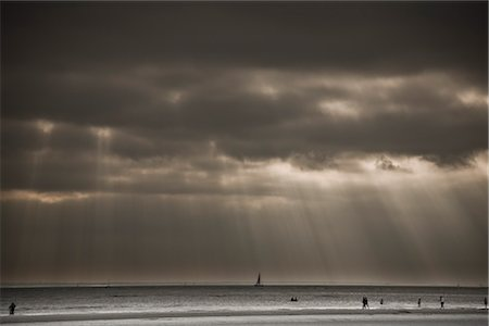 sailing boat storm - Sunrays through Dark Sky, West Wittering Beach, West Sussex, England, UK Stock Photo - Rights-Managed, Code: 700-03244049