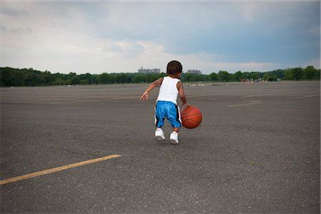 Young Boy Playing Basketball Stock Photo - Rights-Managed, Code: 700-03244343
