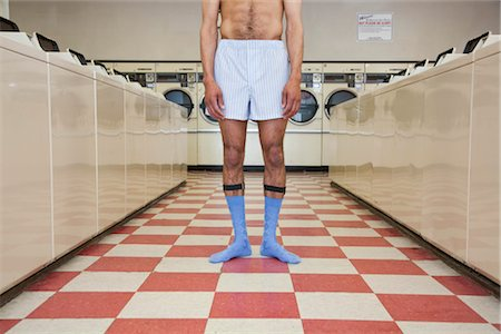 Man in Underwear Standing in Laundromat Stock Photo - Rights-Managed, Code: 700-03294847