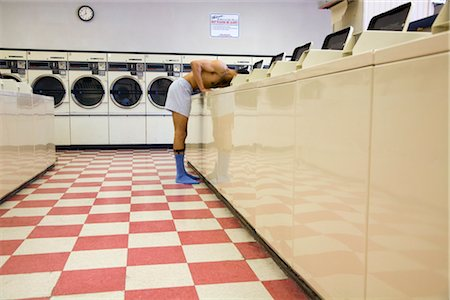 Man in Underwear Doing His Laundry in Laundromat Stock Photo - Rights-Managed, Code: 700-03294848