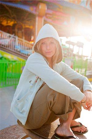 Portrait of Woman Sitting on the Boardwalk in Santa Cruz, California, USA Stock Photo - Rights-Managed, Code: 700-03295008