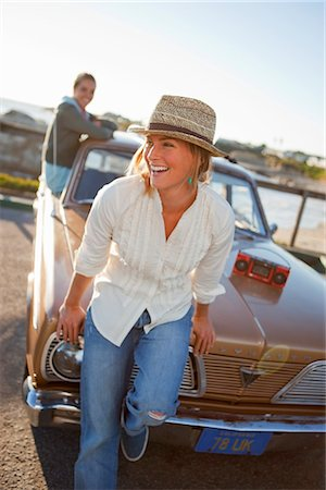 Woman Sitting on the Hood of a Vintage Car at the Beach, Santa Cruz, California, USA Stock Photo - Rights-Managed, Code: 700-03295054