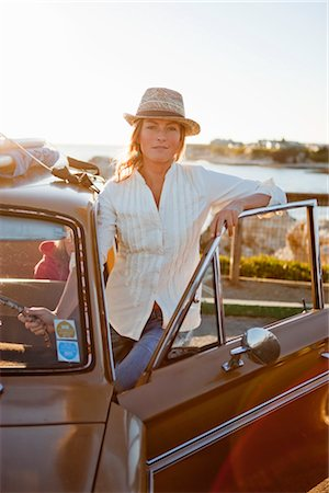Portrait of Woman With a Vintage Car, Santa Cruz, California, USA Stock Photo - Rights-Managed, Code: 700-03295056
