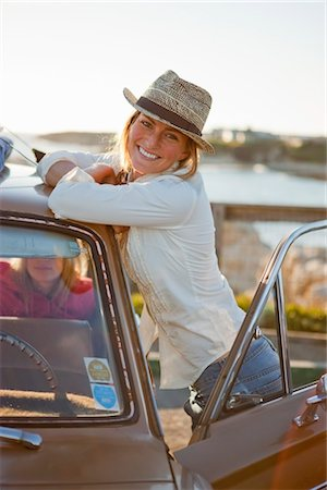 Portrait of Woman With a Vintage Car, Santa Cruz, California, USA Stock Photo - Rights-Managed, Code: 700-03295057