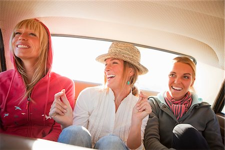 Group of Friends in the Back Seat of a Vintage Car, Santa Cruz, California, USA Stock Photo - Rights-Managed, Code: 700-03295064