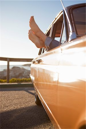 Woman's Feet Sticking Out the Window of a Vintage Car, Santa Cruz, California, USA Stock Photo - Rights-Managed, Code: 700-03295067