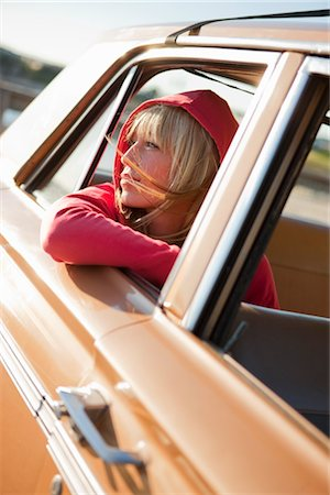 Woman Leaning Out the Window of a Vintage Car, Santa Cruz, California, USA Stock Photo - Rights-Managed, Code: 700-03295060