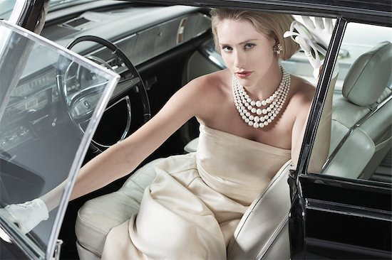 Portrait of Glamourous Woman in a 1964 Chevrolet Imperial LeBaron Stock Photo - Premium Rights-Managed, Artist: Michael Mahovlich, Image code: 700-03295279