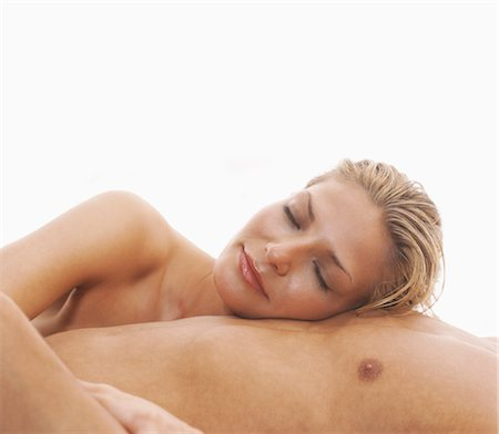 Woman Lying on Man's Chest Stock Photo - Rights-Managed, Code: 700-03298814