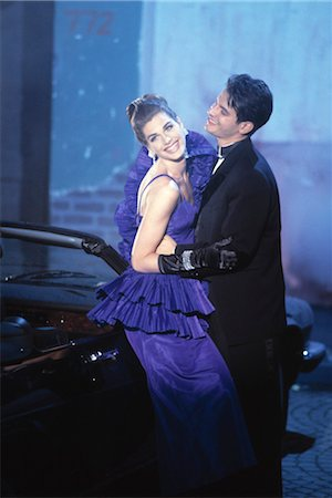 Couple standing by Car wearing Evening Clothes Stock Photo - Rights-Managed, Code: 700-03298811