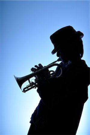 Silhouette of Boy Playing Trumpet Stock Photo - Rights-Managed, Code: 700-03299206