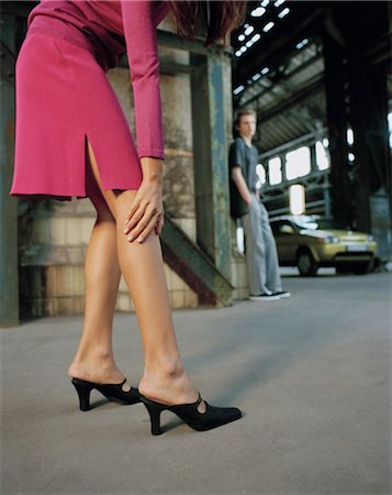 Woman in High Heels, Man in the Background Stock Photo - Rights-Managed, Code: 700-03299200