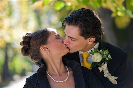 Bride and Groom Kissing, Salzburg, Salzburger Land, Austria Stock Photo - Rights-Managed, Code: 700-03299229