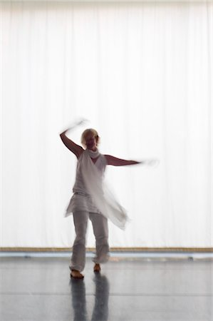 Woman Dancing in Front of a White Curtain, Salzburg, Salzburger Land, Austria Stock Photo - Rights-Managed, Code: 700-03299223