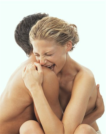 Close-up of Nude Couple, Woman Biting Man's Shoulder Stock Photo - Rights-Managed, Code: 700-03290109